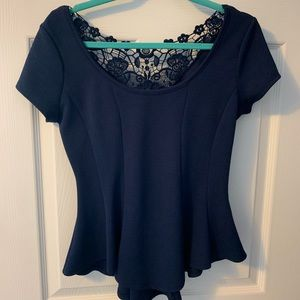 Navy peplum lace back top